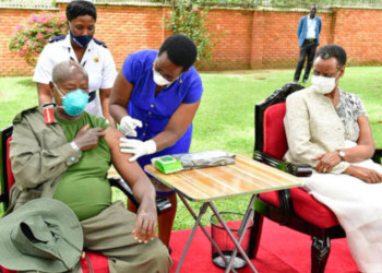 President Museveni and wife Janet receiving their first Covid-19 vaccine jab (PHOTO/Courtesy).