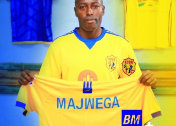 Majwega holds a KCCA FC shirt after signing on Sunday. (PHOTO/KCCA FC)