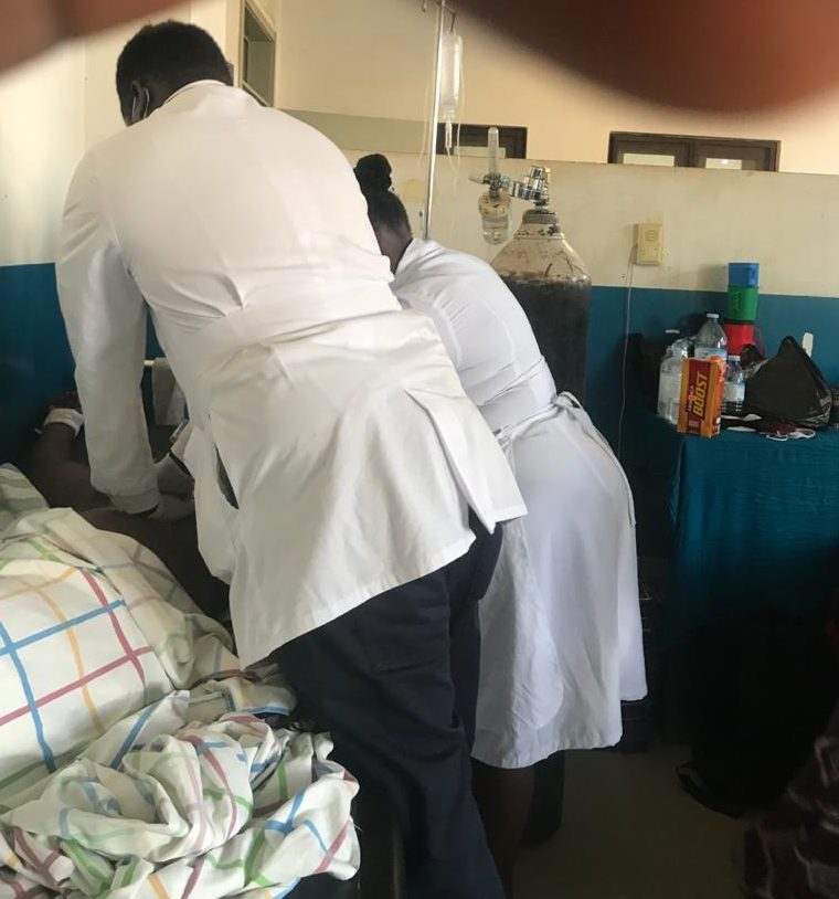 Health workers examine a Covid-19 patient (PHOTO/Courtesy)