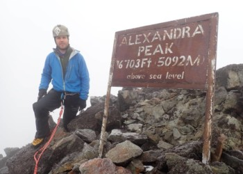 Julian Wright, a professional mountaineer, lead guide/ field expert with over 15 years' experience poses for a photo at the Alexandra Peak (5,090 metres), of Mt. Stanley's four tallest peaks. Julian set a record, by climbing 8 peaks in 7 days. Over and above Alexandra, the three other Mt. Stanley peaks summitted by Julian are: Margherita, (5,109 metres), Albert Peak (5,087 metres), and Cheptegei (4,907 meters).  He also summited Mutinda Lookout (3,975 metres); Mt. Speke's tallest peak- Vittorio Emanuele (4890 metres) as well as Iolanda Peak, (4,175 metres) the tallest peak on Mt. Gessi and finally, Mt. Baker's Edward Peak (4,844 metres) (PHOTO/Courtesy).