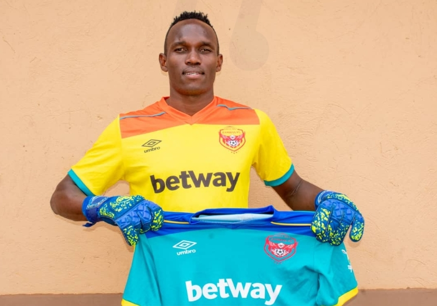 Mutakubwa poses with an Express jersey during his unveiling on Wednesday. (PHOTO/Express FC)