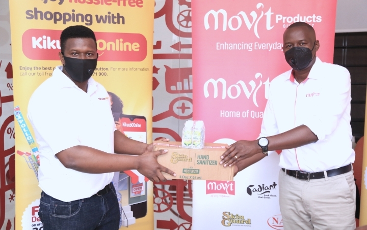 The KikubOOnline Marketing Manager  Paul Receiving Skin Guard Products from the Skin Guard Brand Manager Movit Products (PHOTO /Courtesy)