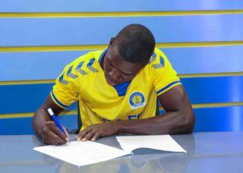 Baligeya penning down his three-year deal at URA FC. (PHOTO/Courtesy)