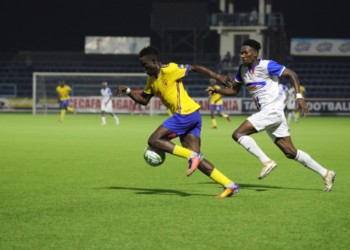 Action between KCCA FC and Azam FC at the Azam Complex in Chamazi on Monday night. (PHOTO/Courtesy)